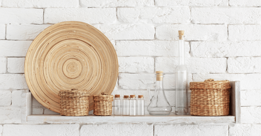 decorate a shelf with glass and neutral colors