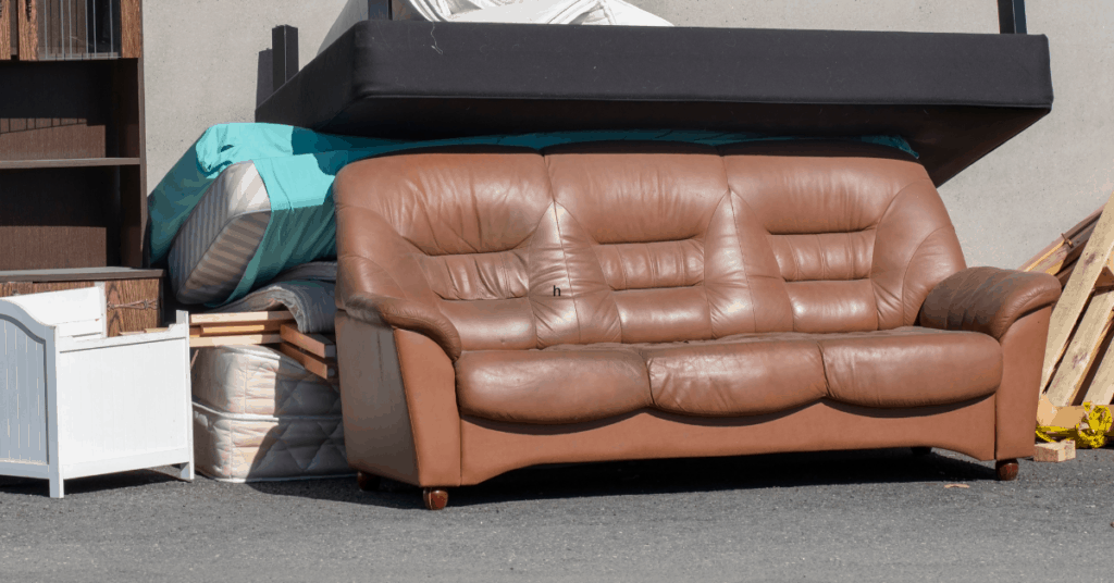 decorating on a budget throw away old furniture brown couch