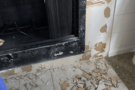 Remove tile from around the fireplace as part of fireplace remodel