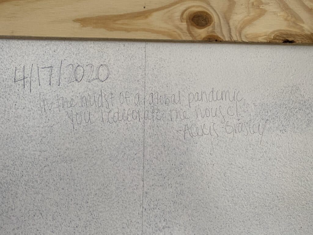 plywood shiplap write on wall behind it