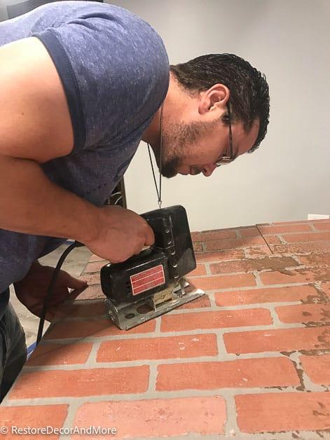 cut brick paneling with a jigsaw