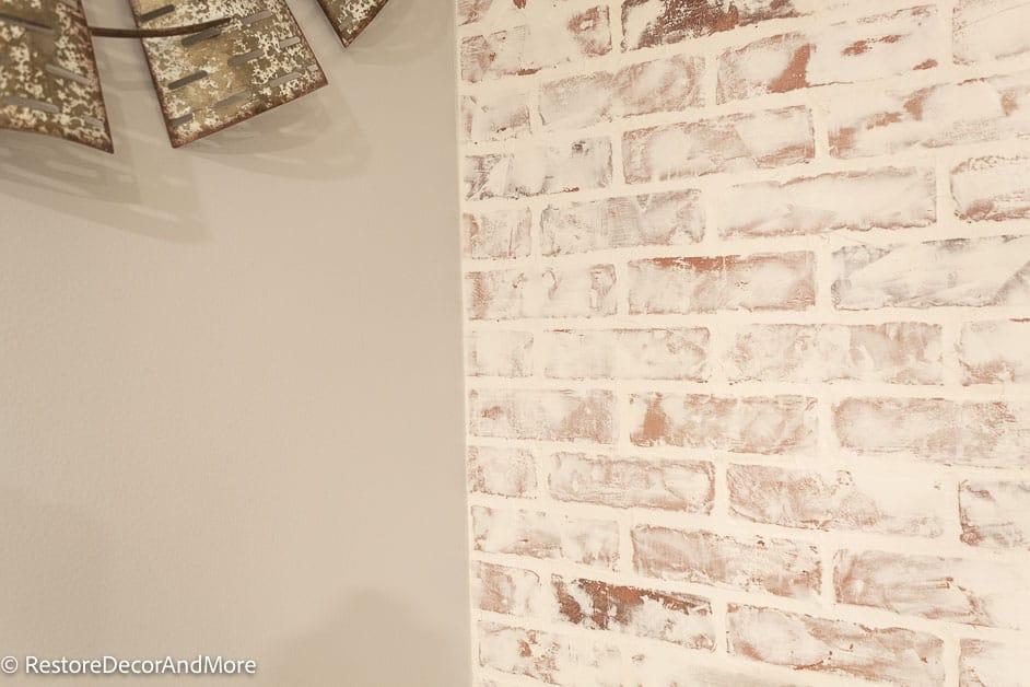 add caulk to corner of fake brick wall