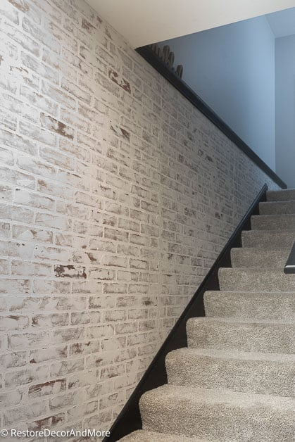 fake brick wall going up the stairs
