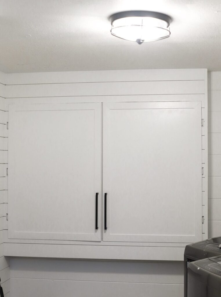 Hide electrical panel by creating a faux cabinet