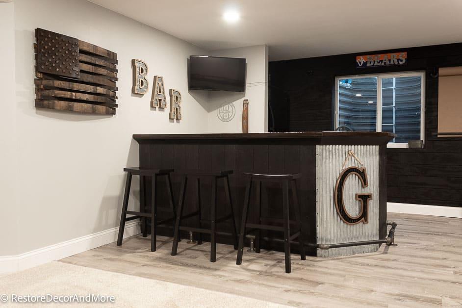 Finished Basement dry bar and whiskey barrel flag decor