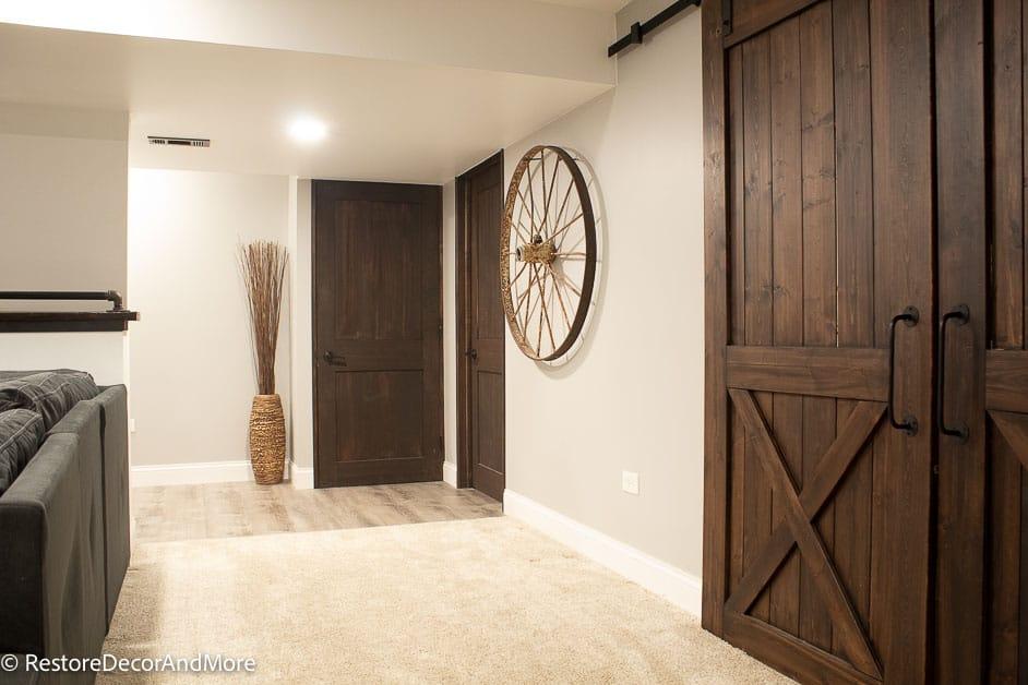 Finished Basement view of barn doors and regular doors