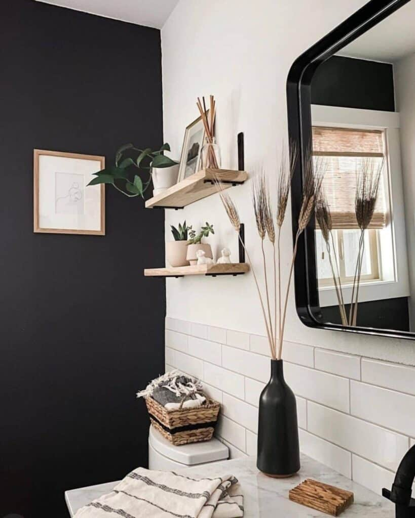 Black Accent Wall in bathroom with black and cream and wood accesorries