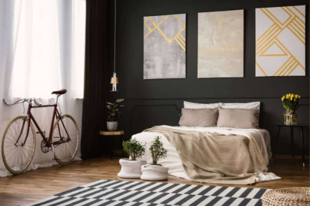 Black accent wall with wainscoting in bedroom