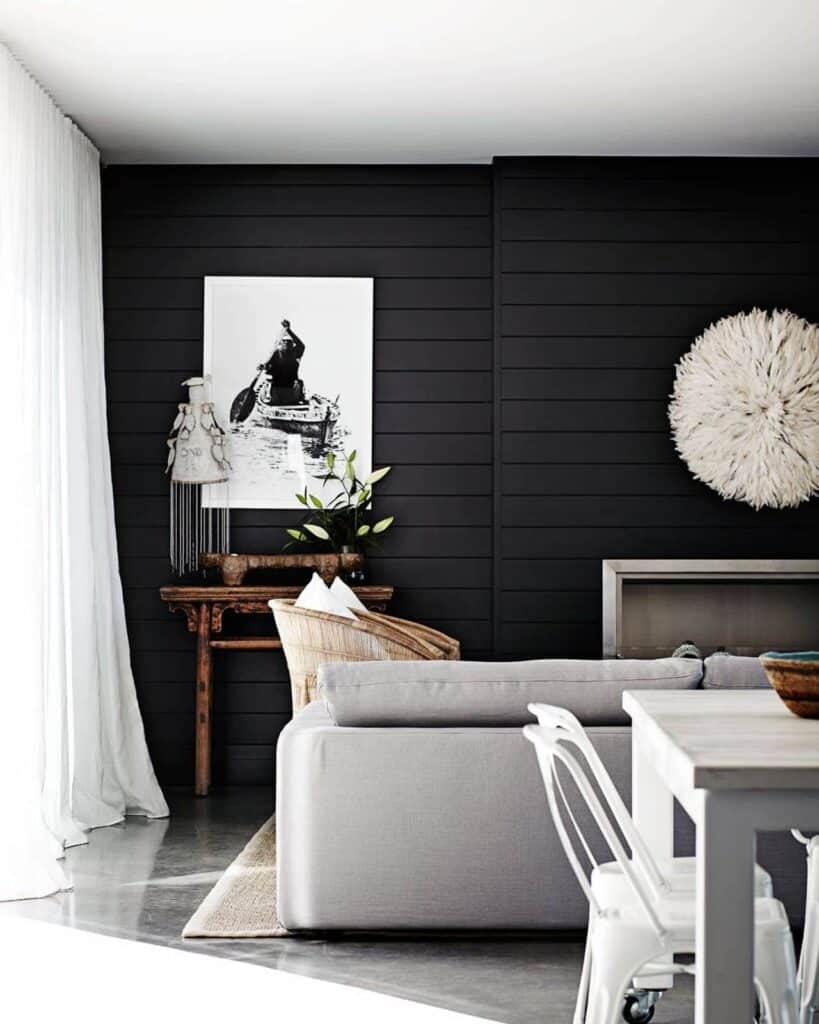 Black Shiplap Wall Living Room with black and white picture and white curtains