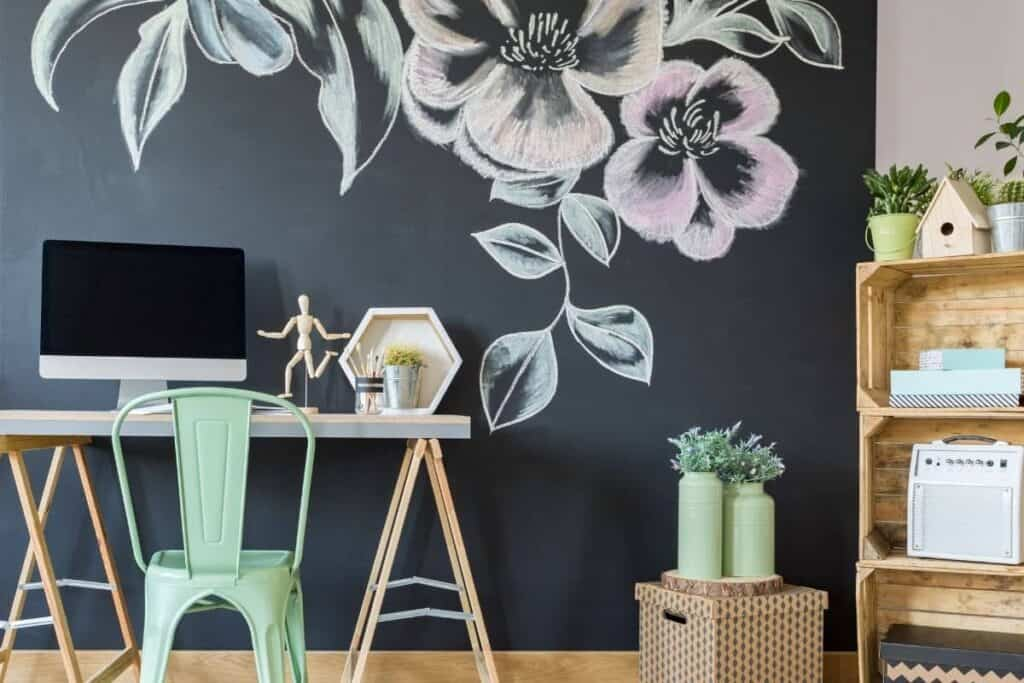 Chalkboard wall with flower mural in home office