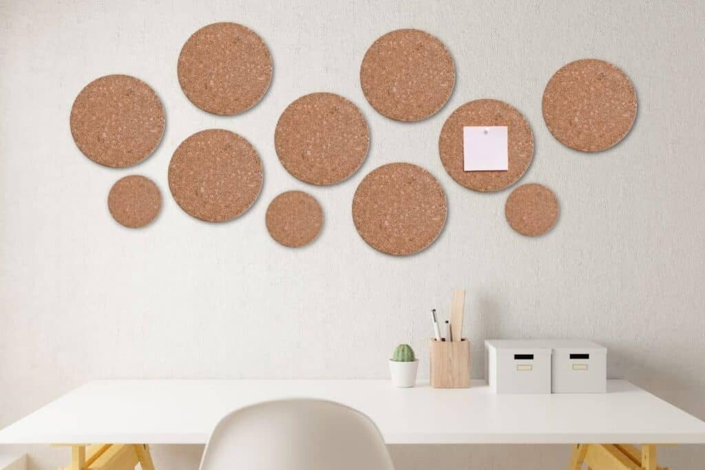 multiple cork trivets on wall in home office