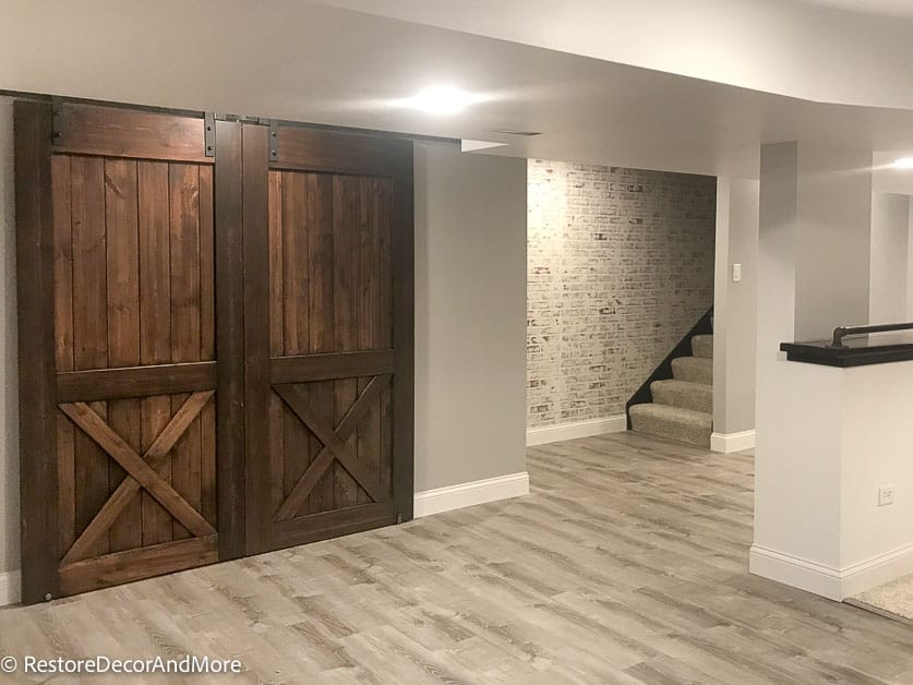 French barn doors in finished basement for storage closet