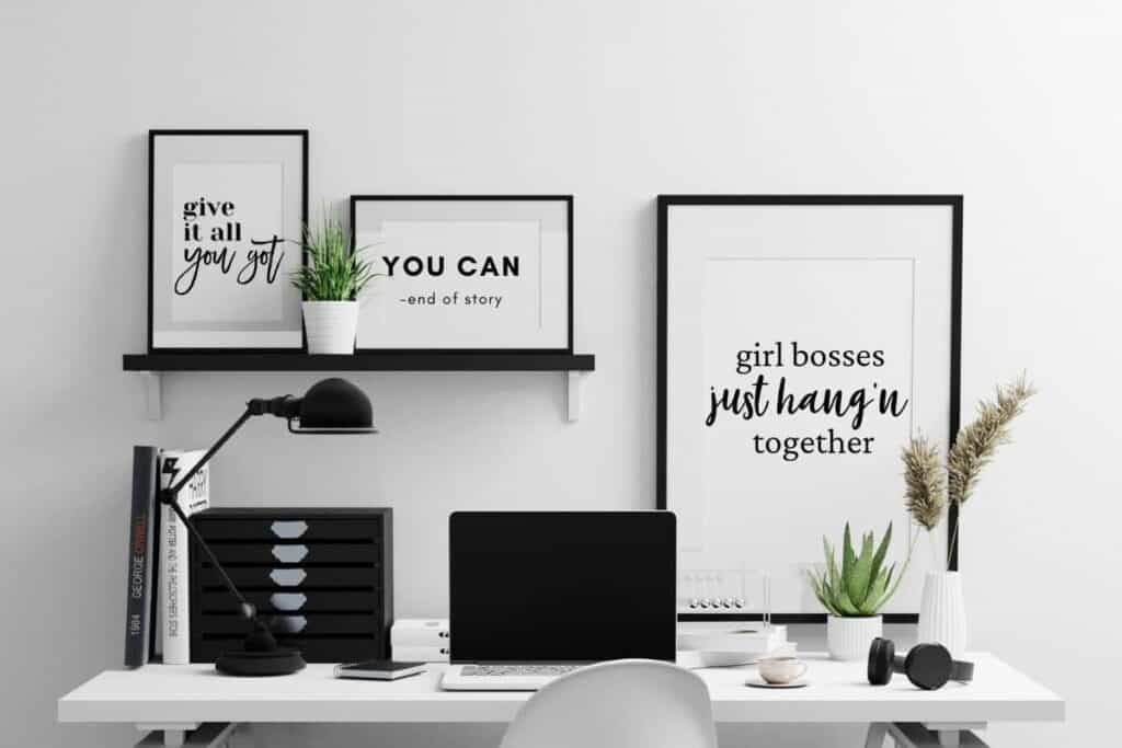 black and white inspirational quotes framed on wall in home office