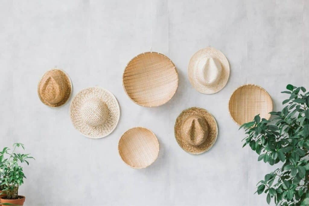 straw hats on wall