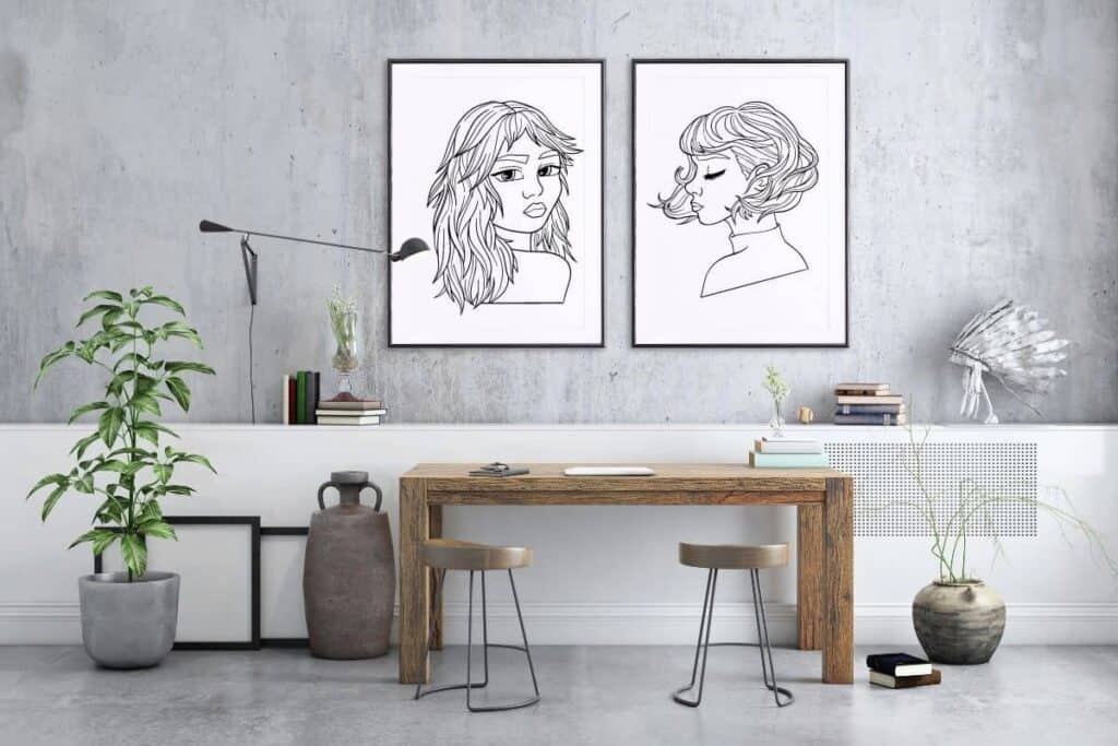 two large oversized pieces of artwork on wall in home office