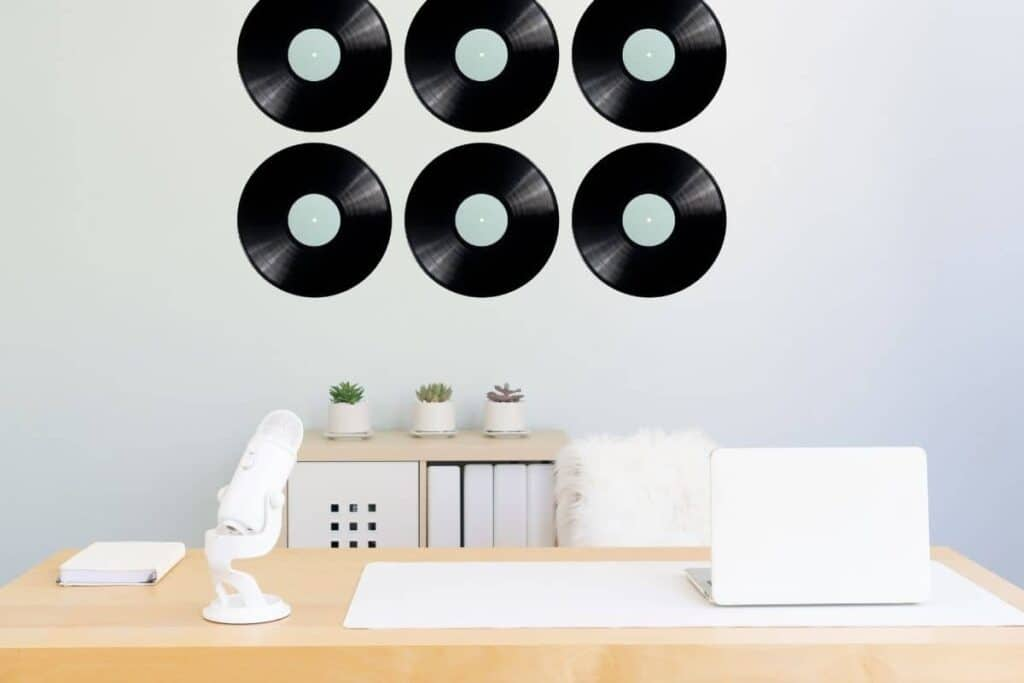 vinyl records on wall in home office