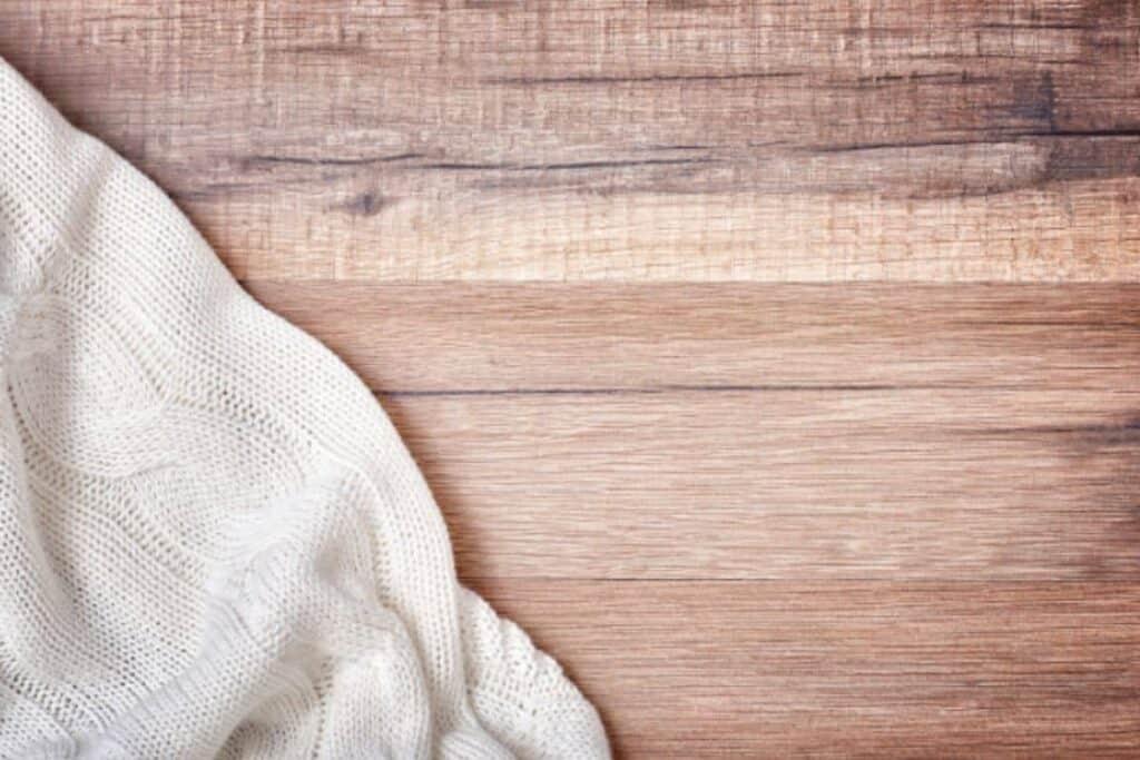 White knit blanket on wood background