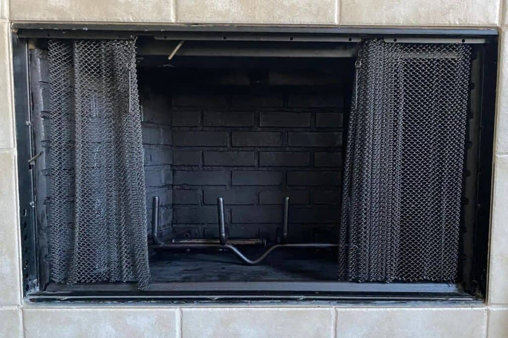 after picture of inside of fireplace brick using black high heat paint