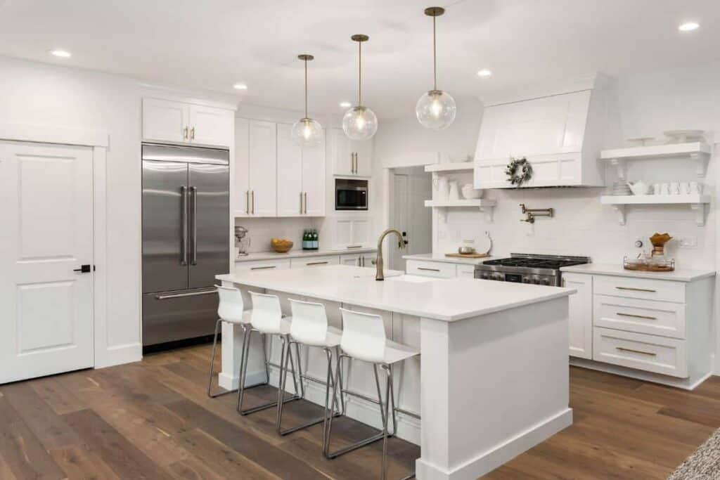 WHITE MODERN FARMHOUSE KITCHEN WITH GOLD HARDWARE AND STAINLESS STEEL APPLIANCES