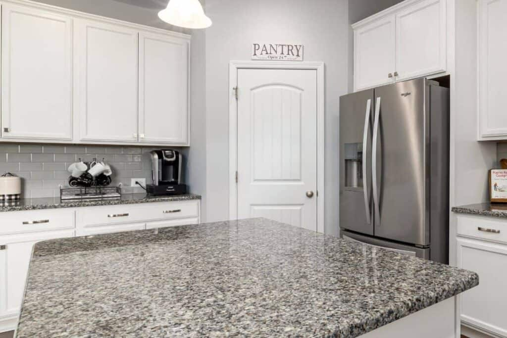 White Pantry Door In Kitchen With Pantry Sign above