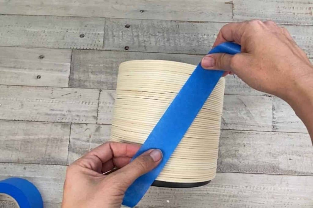 Blue painters tape to create a diagonal before painting diy planter