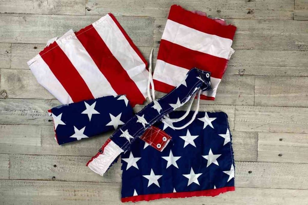 AMERICAN FLAG SHORTS CUT UP INTO PIECES FOR FABRIC FOR DIY USA SIGN