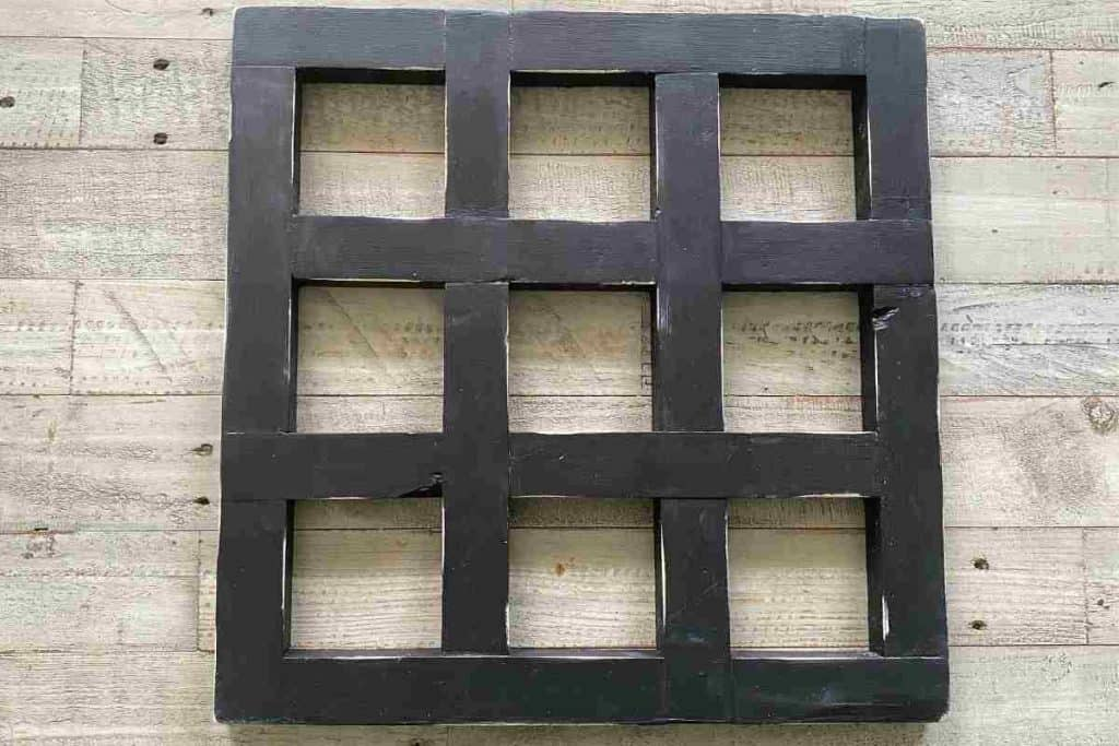 black wooden tic tac toe board distressed