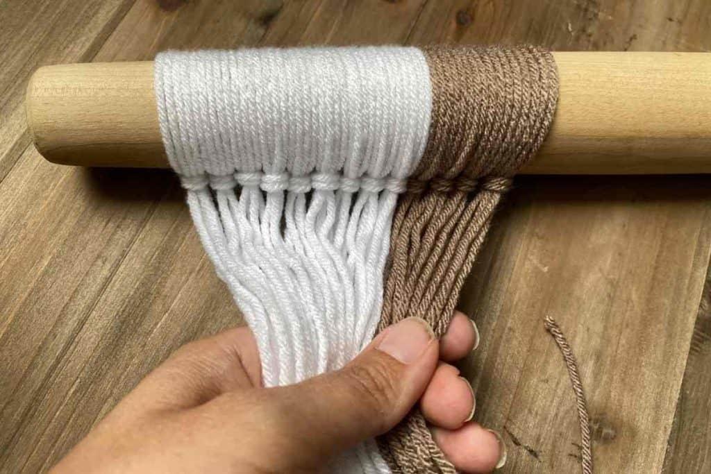 In Process of adding yarn to yarn wall hanging