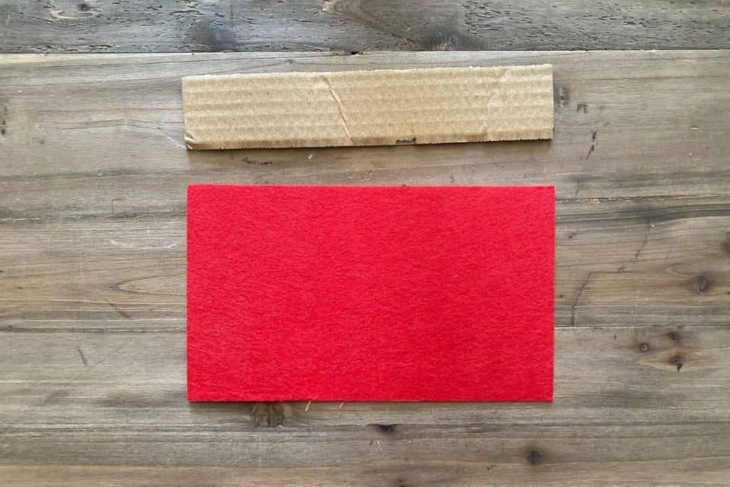 piece of cardboard and piece of red felt