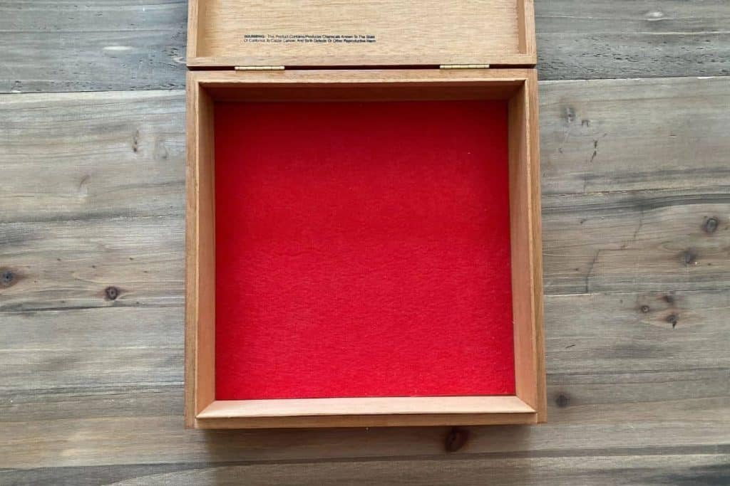 red felt in bottom of empty cigar box to create wooden dice tray