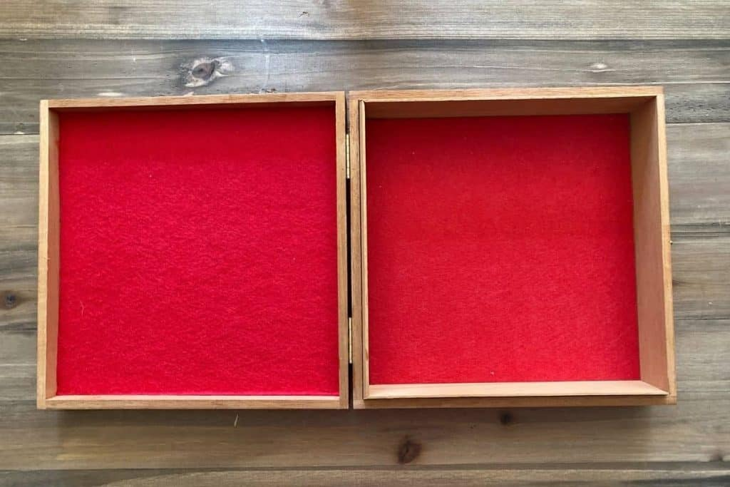 red felt in top and bottom of empty cigar box to create a diy dice tray