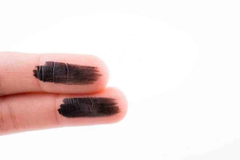 BLACK PAINT ON FINGERS