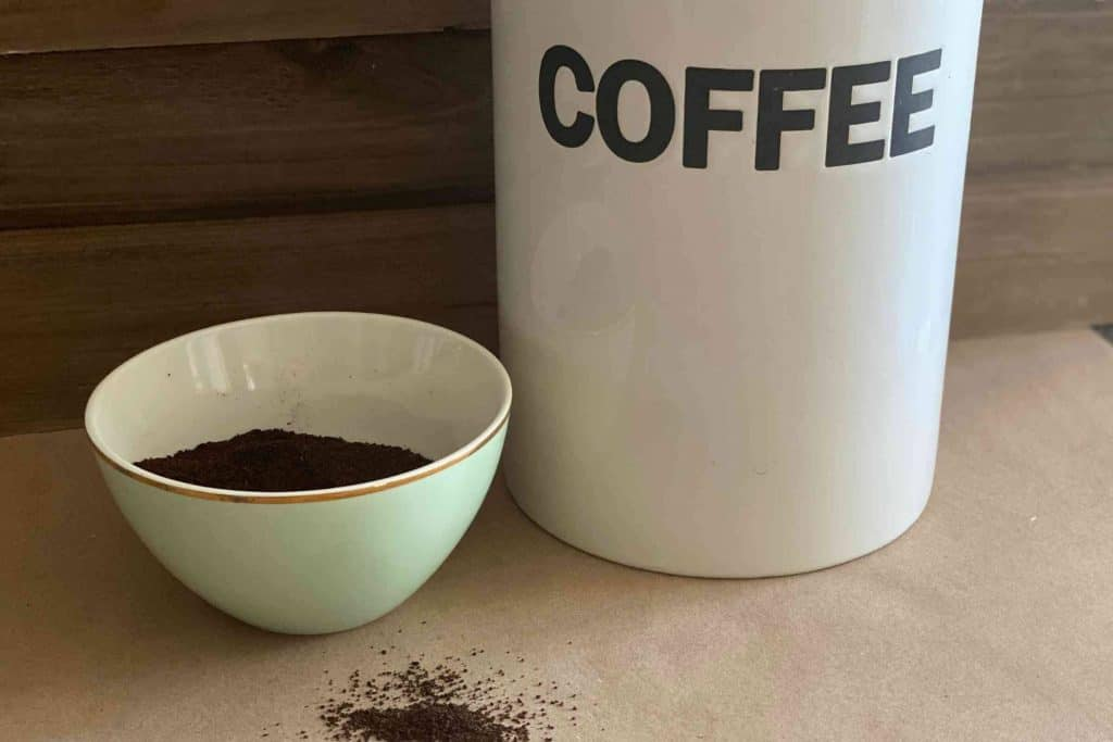 Coffee Canister With Coffee grounds in bowl
