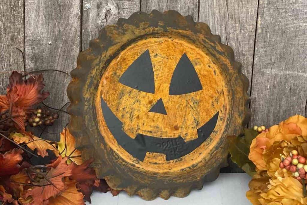 Rust pumpkin diy craft using rust effect paint and thrift store dessert pan