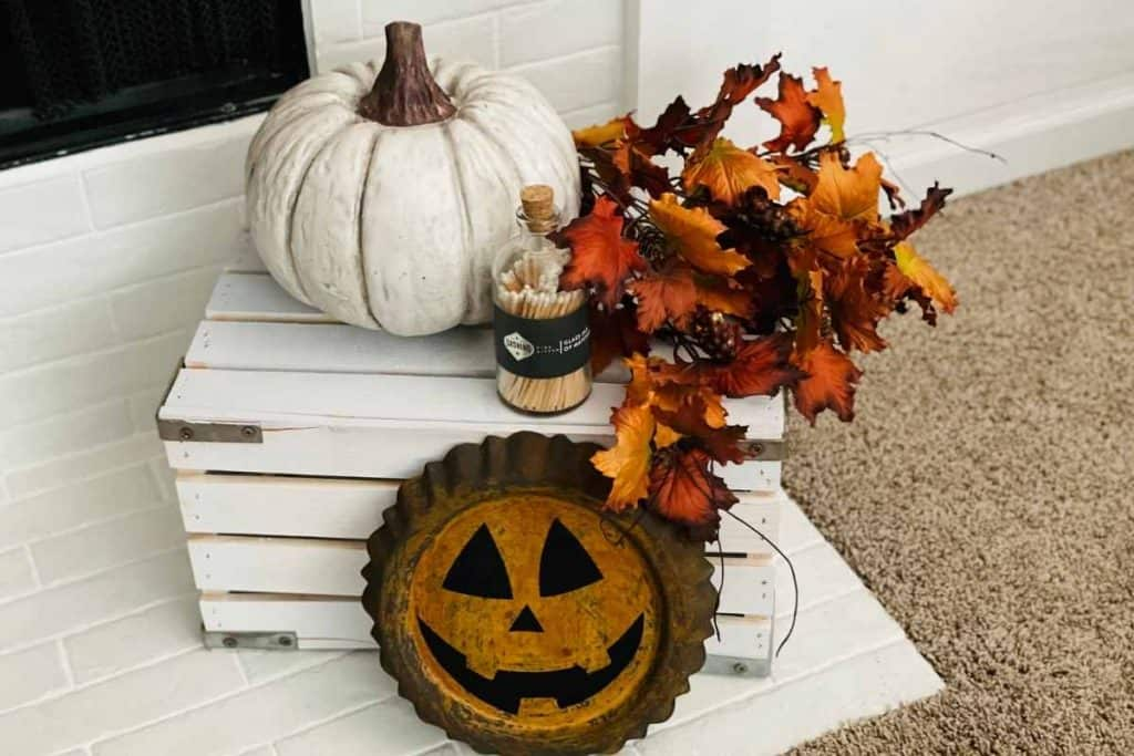 white wooden crate with pumpkin decor, fall floral, and matches